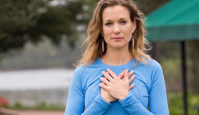 blue-shirt-hand-over-heart